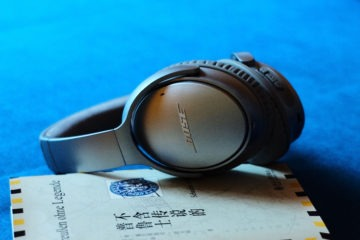Bose QC35 Noise cancelling headphones over book -