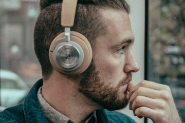 Man wearing headphones wondering if they increase ear wax production