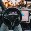 Man sitting inside a tesla with no cabin noise