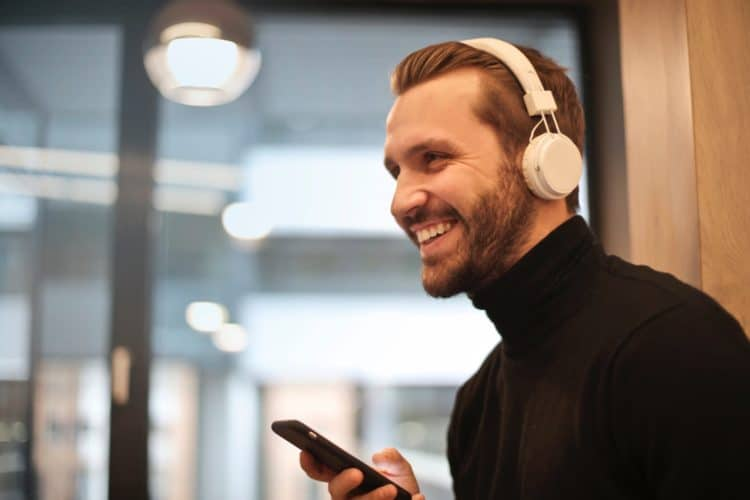 Man wearing headphones for one hour per day to avoid hearing damage