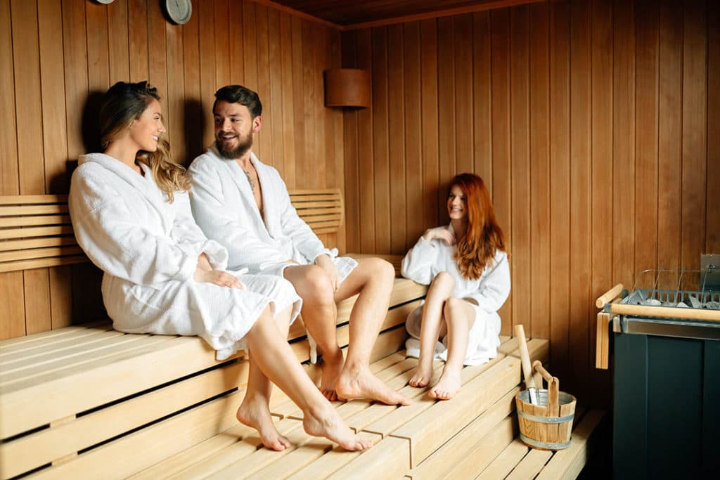 Friends chose to relax instead of using their headphones in the sauna