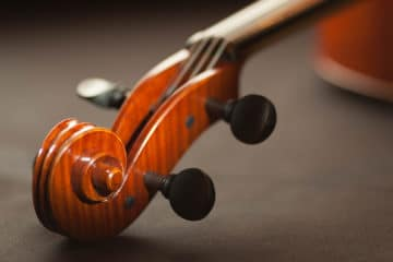 Geared pegs on a violin why isn't everyone using them